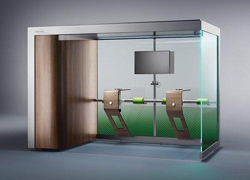 Raucherkabine (Modell ST.328-DESIGN) für 8 Personen mit 2 Tischmodulen, einem TV-Gerät (Ausstattungsbeispiel) und einer Mobiltelefon-Ladestation.