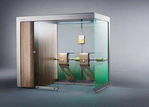 Smoking cabin as a fully enclosed smoking room with front closure and a document holder.